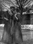 Two women posed in winter scene