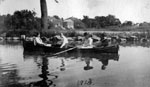 Four women rowing boat