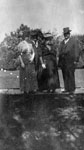 Two men and two women posed in garden