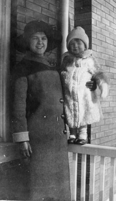 Woman and small boy on porch