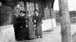 Group of four women waiting on station platform