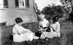 Three women with pets
