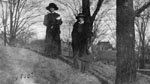 Two women posed by trees