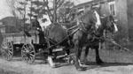Horses pulling wagon outside 57 Martin St., Milton