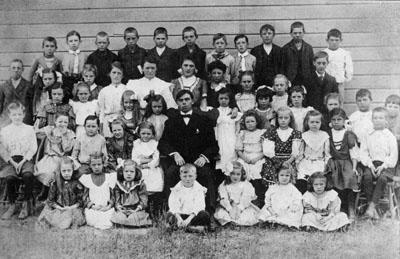 Ligny School.   Class photograph.   Students and teacher.