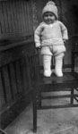 Young child standing on chair
