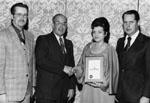 Olive and Gordon Krantz receiving award
