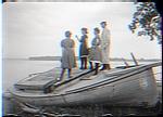 3 women 1 man on boat