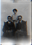 Woman Standing Behind 2 Seated Men in Posed Photo