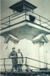 People standing in front of the Lighthouse, Lake Cecebe, circa 1920