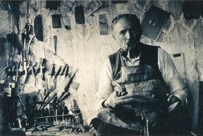 Shoemaker Johnny Fletcher in Workroom, circa 1900