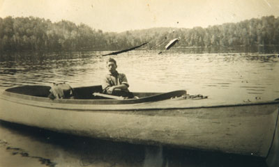 Hughie Bell in his Delivery Boat, Back Bay, circa 1915