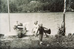 A Family Unloading their Canoes, circa 1920