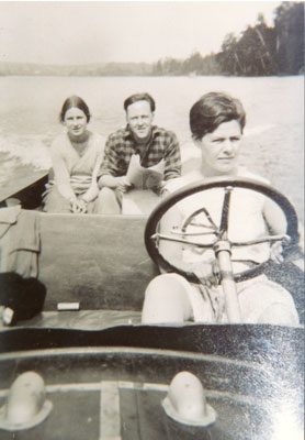 Young Woman Driving a Motorboat, circa 1920