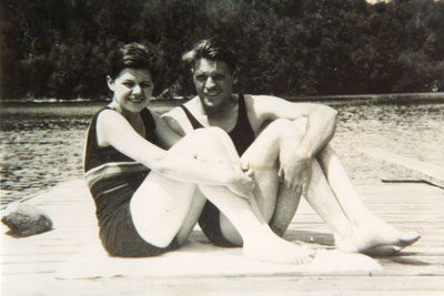 Young Couple Sitting on a Dock, circa 1920