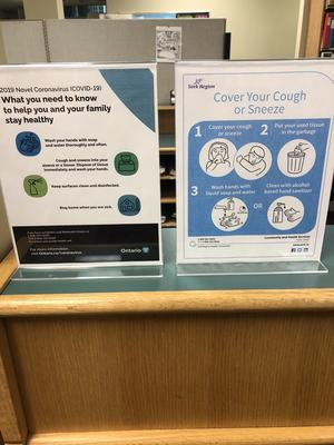 Personal hygiene signs at Adult Information Desk