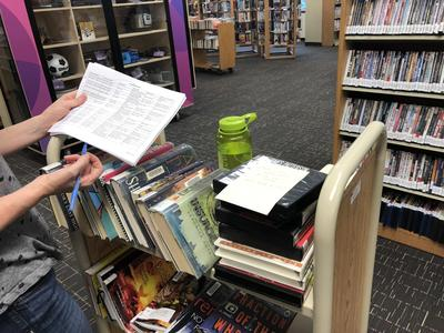 Library staff gathering material for curbside pick up