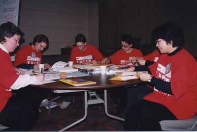 Volunteers collating session statistics