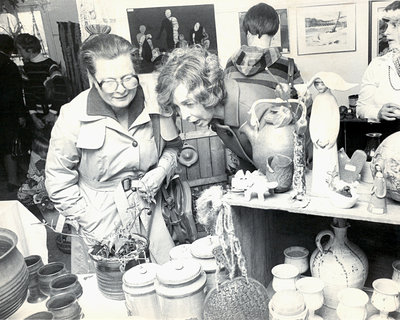Two ladies looking at pottery