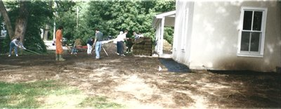 Levelling the area and laying sod