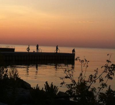Fishing off the pier at Oakville Harbour