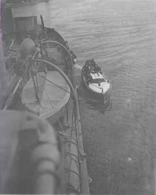 Admiral Nelles Approaches HMCS Oakville in Launch