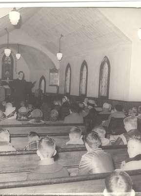 Sunday school class or church service perhaps?