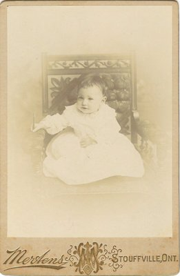 Photograph of a baby on a chair