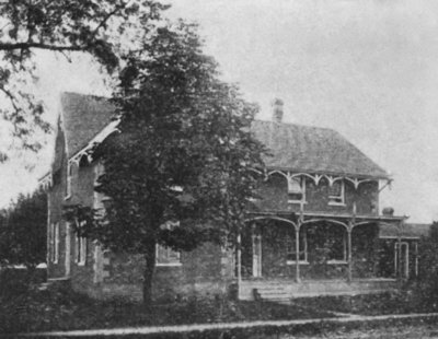 A photograph of the old parsonage at the north east corner of Church and Centre St.