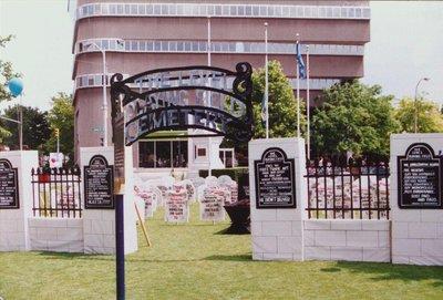 CAW's Graveyard Display Regarding Federal Cuts