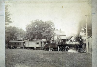 An Steam Engine and Passenger Cars