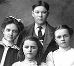 Studio photograph of Amy, Belle, and Georgina Van Exan and William Corbett, Smiths Falls