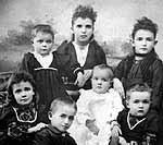 Studio photograph of Mabel, Sarah, James, Maria, Georgina, Bella, Charlotte and Violet Van Exan, Smiths Falls
