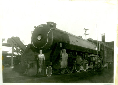 Railroad Employee Posing for Photograph on Canadian Pacific Railway Engine 2827