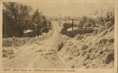 R3CV.  Main Street in Winter, Rosseau, Ontario, Canada