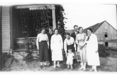 Erven Family in front of house and barn, circa 1930