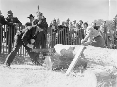 Two Men Sawing, South River Agricultural Society Fall Fair, circa 1960