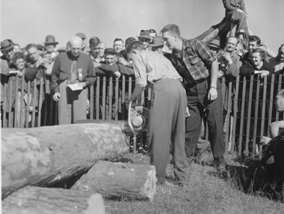 Man Chainsawing a Log,  South River Agricultural Society Fall Fair, circa 1950
