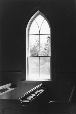 Pew and Window inside St. John's Anglican Church at Eagle Lake