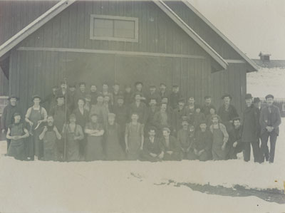 Men Posing for a Photo in the Snow