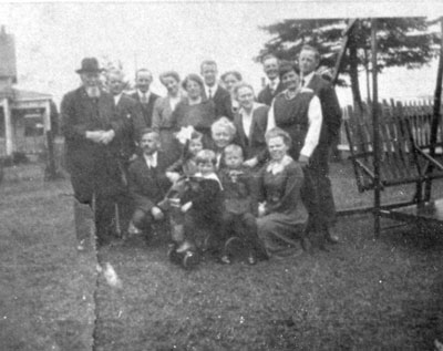 Adults and Children in a Group Picture