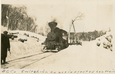 Standard Chemical Company Switching to get in Front of Log Train, circa 1930