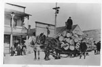 Lumber Sled in front of Neilson's Ice Cream Shop, circa 1910