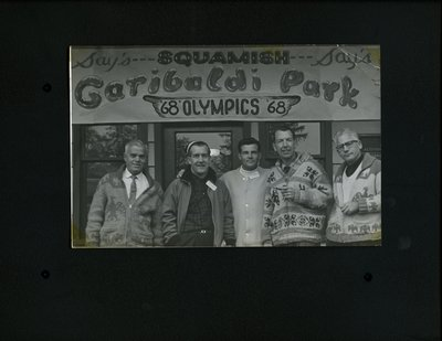 Photograph of five men in front of the Garibaldi Park office during the 1968 Olympics