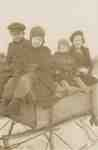 Hank, Jim, Marion, and Isobel Ford on a Homemade Sleigh.