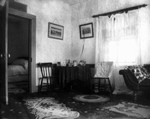 Old home parlour view with bedroom door, ca.1895.  Cavendish, P.E.I.