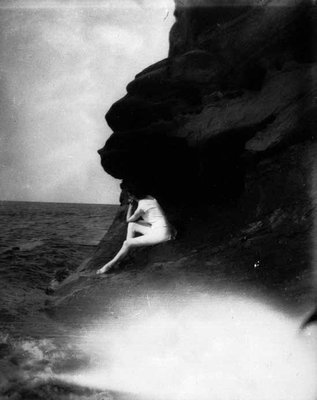 Lucy Maud Montgomery on Cavendish shore in bathing suit, ca.1890's.  Cavendish, P.E.I.