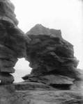 Hole in wall - close up, Cavendish shore, ca.1891.  Cavendish, P.E.I.