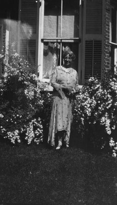 Lucy Maud Montgomery in her garden at Norval, ON. 1932.