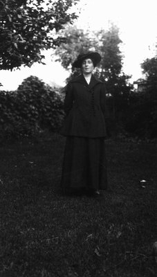 Lucy Maud Montgomery modelling wedding trousseau.  Clothes purchased in Montreal, 1911.  Leaskdale, ON.